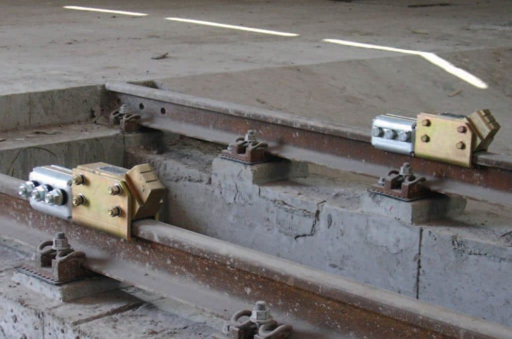 Friction wheel stops for trains
